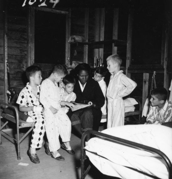 (32334) Counselor Reads to Boys in Cabin, Merrill-Palmer Summer Camp