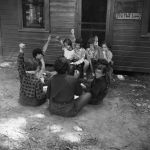 (32342) Counselor and Campers Meet Outside Cabin, Merrill-Palmer Summer Camp