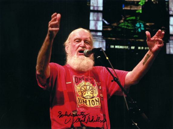 (32369) Utah Phillips Performing at a Rally, Autographed Photograph, circa 2000s