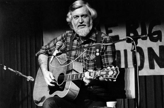(32375) Utah Phillips Playing Guitar and Facing the Crowd During a Performance, Washington, circa 1980