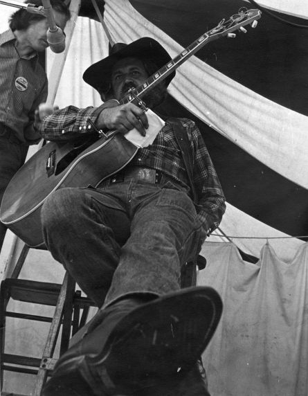 (32390) Utah Phillips Leaning Back on Stage, circa 1970s