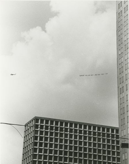 (33041) Janitors rally aerial banner, Pittsburgh PA, 1986