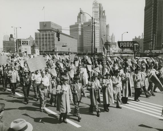 (33497) Janitors marching in parade
