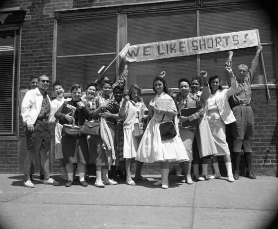 """(37313) Student Activities; Students with """"We Like Shorts"""" signs, circa 1950s."""